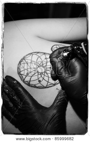 Process of making tattoo, close up