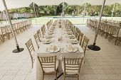 stock photo of mansion  - Decor Dining tables chairs outdoors tent party celebration dinner at private mansion home - JPG