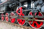 stock photo of locomotive  - lower part of the locomotive on the railroad close up - JPG