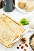 pic of matzah  - Matzah wine eggs chicken greens and haroset on a white background traditional food for the Pesach - JPG