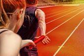 stock photo of relay  - Relay race handing over from woman to man - JPG