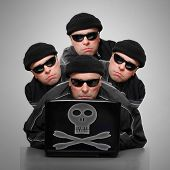 stock photo of anonymous  - Group of anonymous hackers or terrorists with laptop - JPG