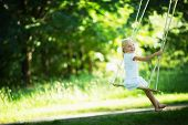 picture of swing  - Little girl on a swing in the park - JPG