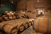 picture of wine cellar  - Wine barrels stacked in the old cellar - JPG