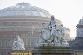 Постер, плакат: Albert Memorial statue overlooking hazy Royal Albert Hall in London The concert hall is home to th