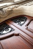 foto of mansion  - Stylish wooden door on the facade of a French mansion - JPG