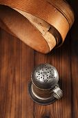 picture of flour sifter  - Vintage  Baking Tin cutters on metal backdrop - JPG