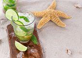stock photo of mojito  - Fresh mojito drink on beach - JPG