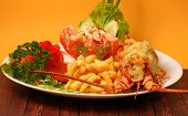 picture of lobster  - Lobster thermidor baked lobster served with shrimp cocktail and French fries - JPG