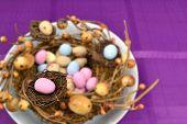 image of bird egg  - Easter eggs inside a decoration that looks like bird nests - JPG