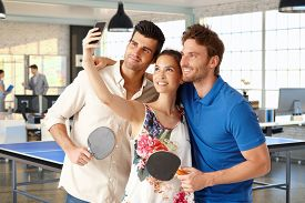 picture of ping pong  - Young companionship making a selfie in ping pong hall - JPG