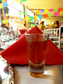 picture of mezcal  - A shot of mezcal served in a traditional mexican party. ** Note: Shallow depth of field - JPG