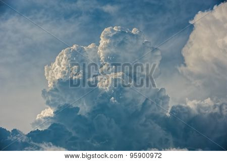 Large fluffy clouds relief details on blue sky