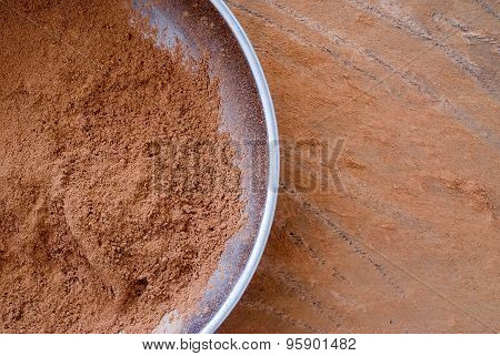 Cocoa Powder In A Metalic Bowl From Above - Close Up Of Textured Background