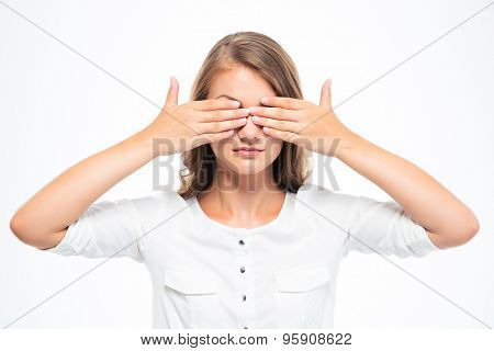 Young woman covering her eyes isolated on a white background