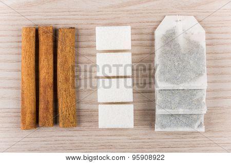 Row Of Sticks Of Cinnamon, Sugar And Tea Bags