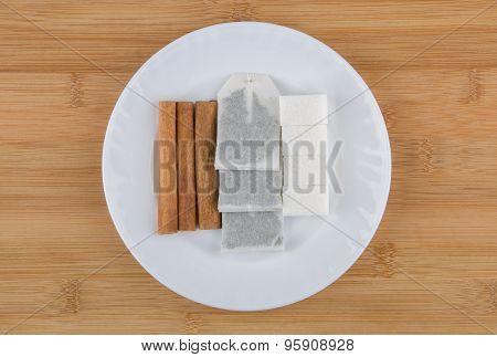 Glass Plate With Sticks Of Cinnamon, Sugar And Tea Bags