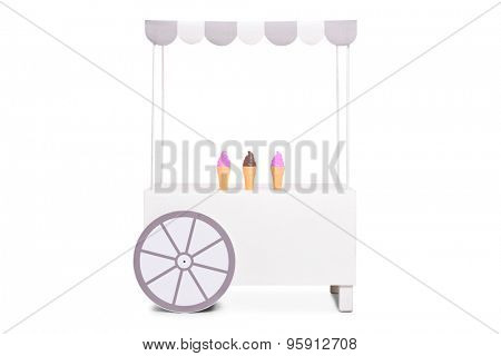Studio shot of a white ice cream stand with a few ice cream cones left on it isolated on white background