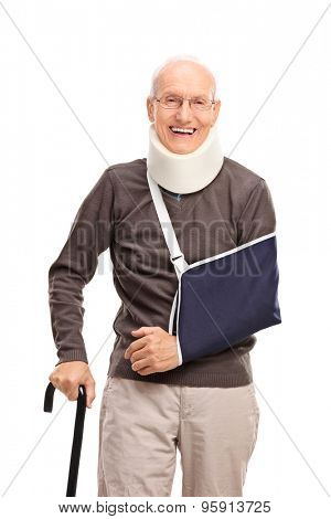 Vertical shot of a senior man with a broken arm smiling and looking at the camera isolated on white background