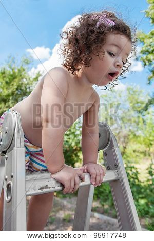 Baby Girl Standing On Ladder