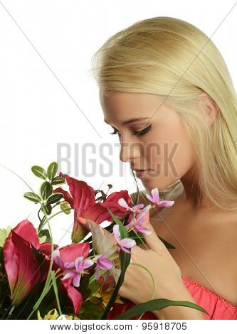 Young Beautiful blond with flowers isolated on a white background