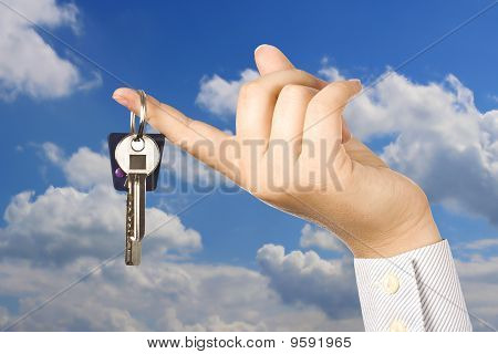Woman Holding A Key
