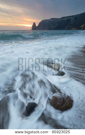 Seascape with beautiful waves on the shore. Sunset. Crimea