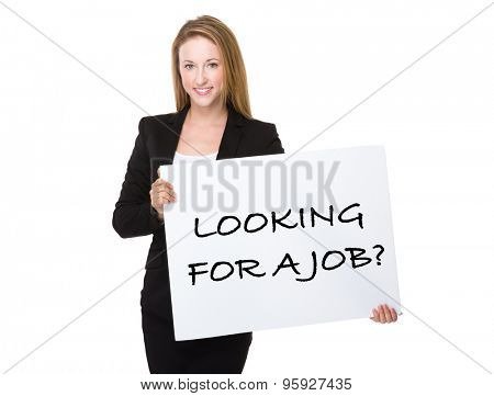 Businesswoman holding with a placard showing phrase of looking for a job