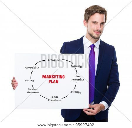 Man with white banner presenting marketing planning