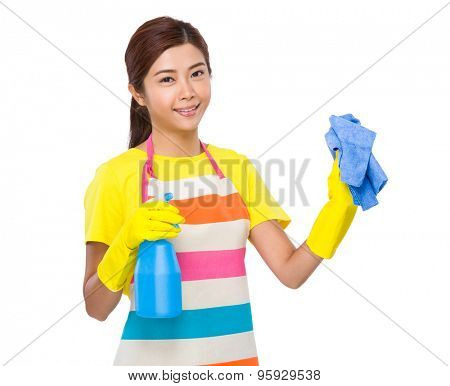 Young housewife clean with bottle spray and rag