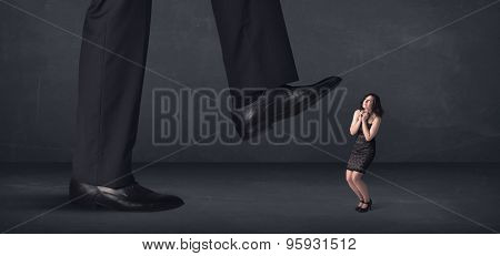 Giant person stepping on a little businesswoman concept on background