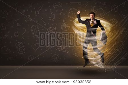 Happy businessman jumping in tornado concept on brown background