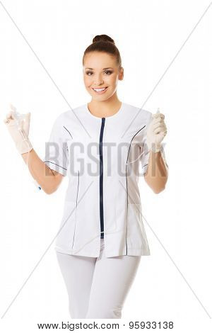 Female nurse holding a drip.