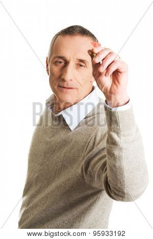 Mature man aiming by dart.