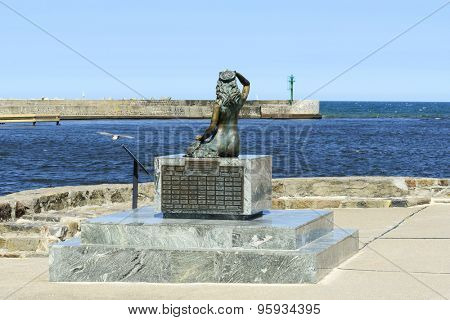 USTKA - JULY 07: A famous statue of the Mermaid in entrance to harbor on 7 July 2015 in Ustka, Poland.