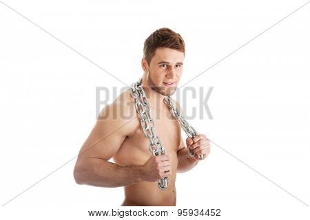 Well build young male model with chains over his body.
