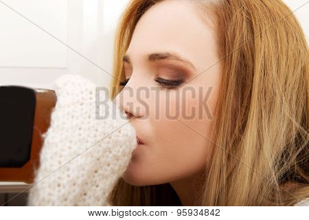 Young beautiful woman in depression, drinking alcohol.