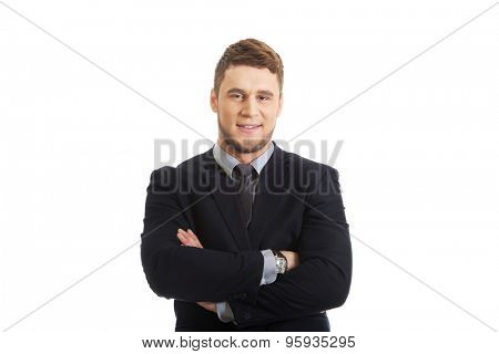 Successful confident businessman with folded arms.