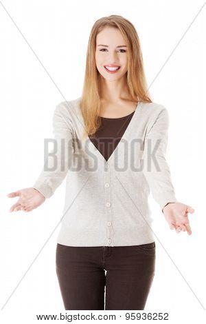Happy woman with open hands gesture.