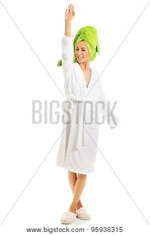 Spa woman in bathrobe with hand up.