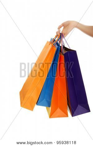 Woman hand with a lot of shopping bags.