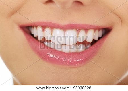 Beautiful young woman toothy smile.