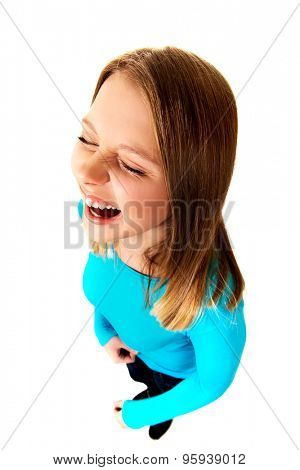 Angry young teen woman screaming