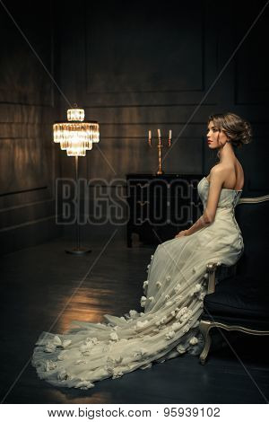 Bride in a white dress in studio