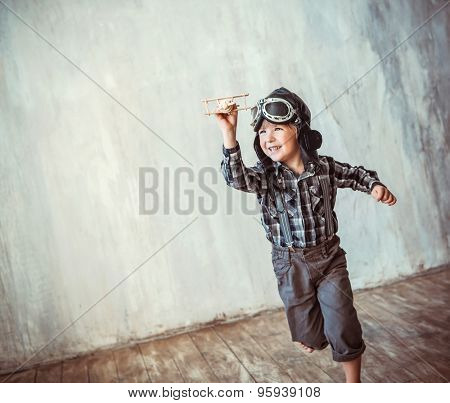 Happy boy running with plane