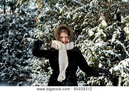 Teenage woman playing snowball fight