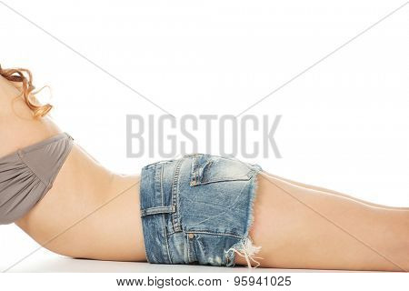 Slim woman body in jeans shorts.