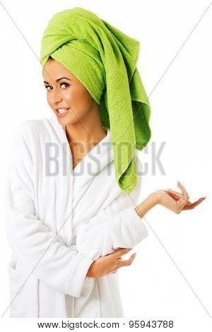 Happy spa woman in bathrobe looking at camera.