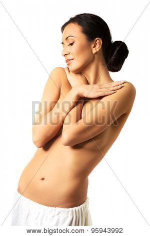 Happy topless woman wrapped in towel.