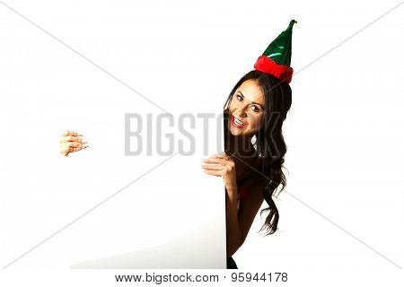 Smiling woman wearing elf clothes holding white banner.
